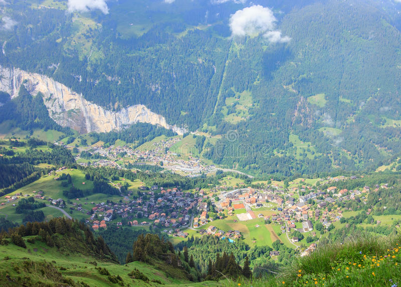 The Mannlichen popular viewpoint over the Lauterbrunnen valley and a popular start location for hikers and skiers. stock photo
