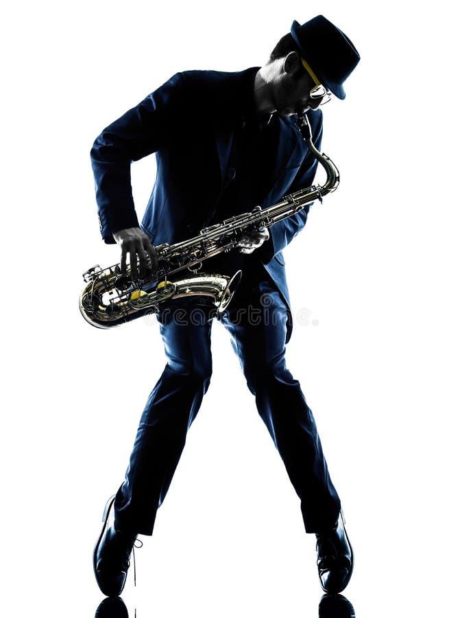 Mannsaxophonist, der Saxophonspielerschattenbild spielt lizenzfreies stockfoto