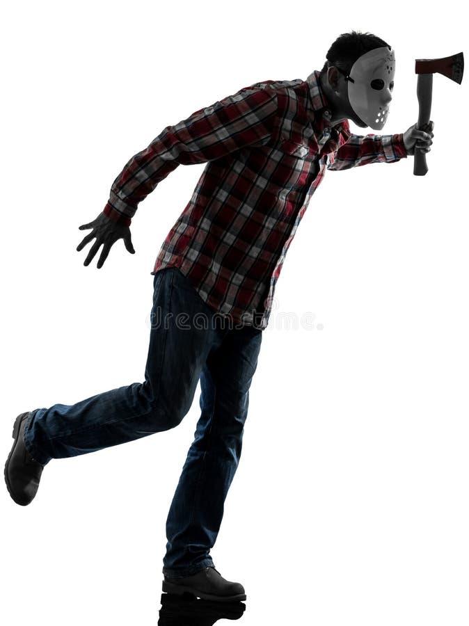 Mannserienmörder mit dem Maskenschattenbild in voller Länge lizenzfreie stockbilder