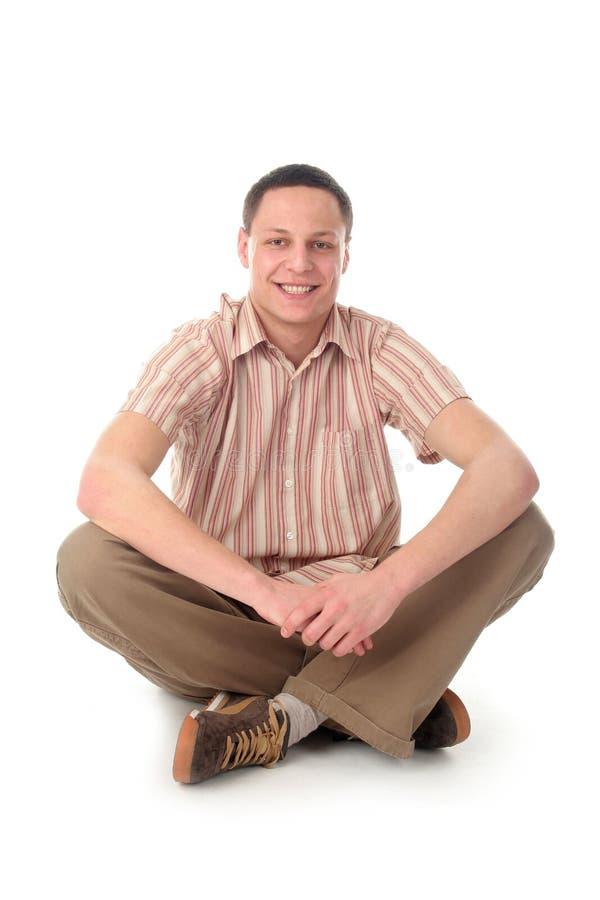 Mannsitzen lizenzfreie stockfotografie