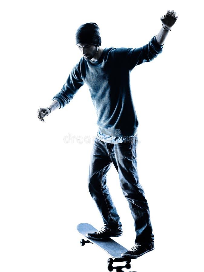 Mannskateboardfahrer, der Schattenbild Skateboard fährt lizenzfreies stockfoto