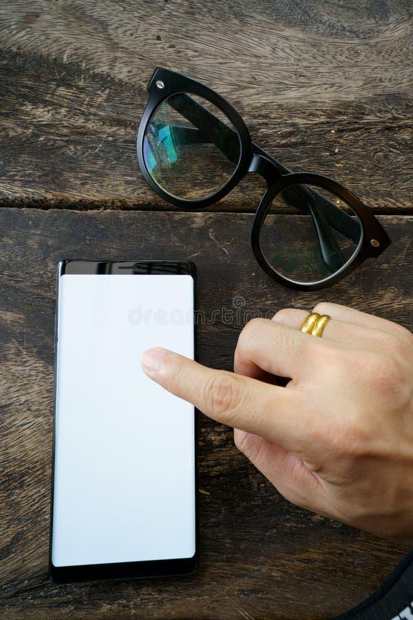 Mannspieltelefon Schwarzfarbe stockbild