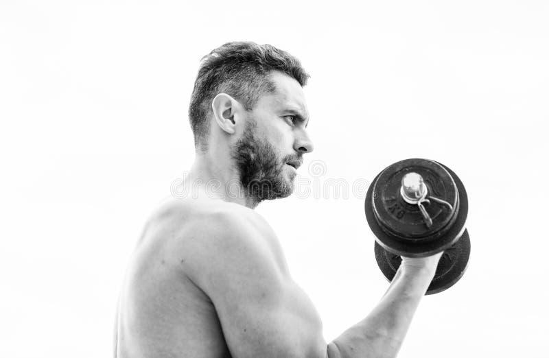 Mannsportler mit den starken H?nden steroide Athletische Karosserie Dummkopfturnhalle Eignung und Sport Muskul?ser Mann, der here stockbild