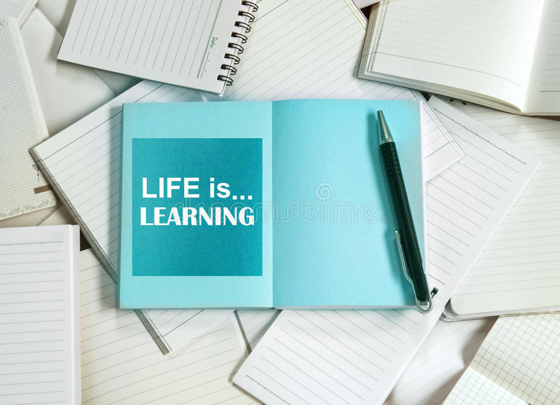 Manny empty notebook paper and note pad background with one blue. Book and life is learning quotes stock photography
