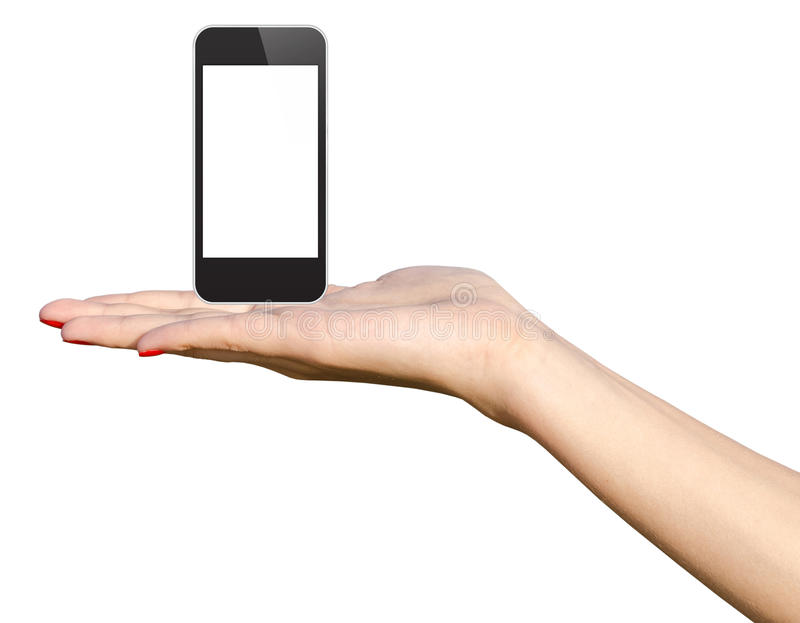 Mano adolescente de la muchacha que sostiene el nuevo teléfono elegante foto de archivo libre de regalías