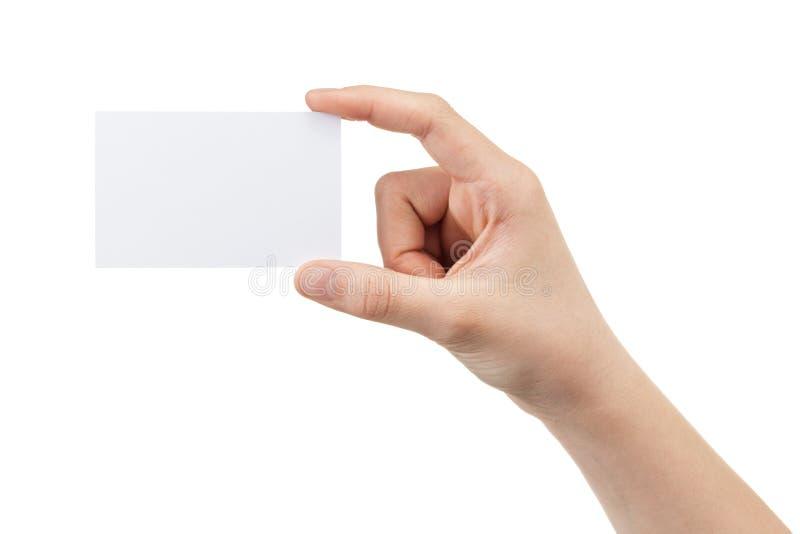 Mano adolescente femenina que sostiene la tarjeta en blanco fotos de archivo libres de regalías
