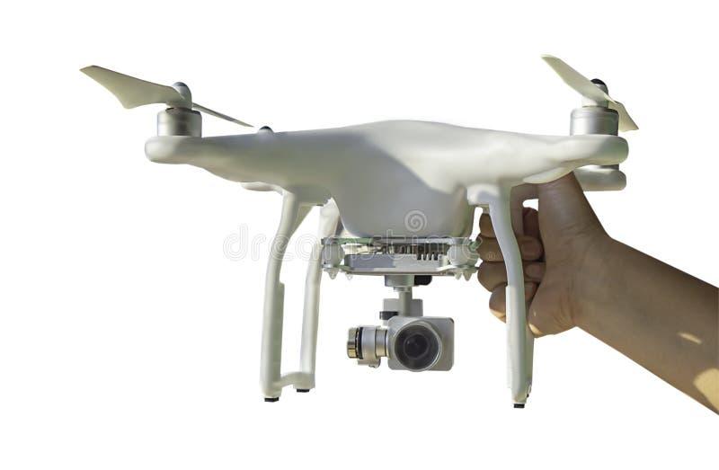 Mano aislada que sostiene los abejones para la fotografía y el vídeo móviles en un fondo blanco con la trayectoria de recortes fotografía de archivo