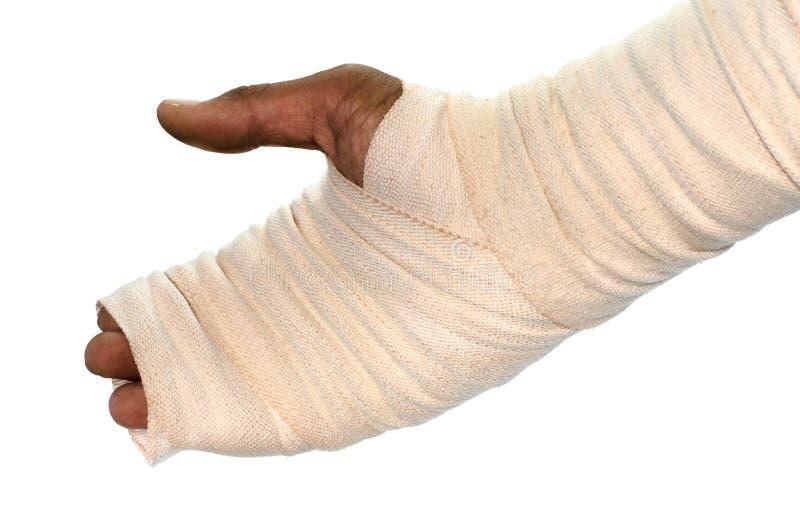 Mano blanca de lesión del vendaje de la medicina en el fondo blanco foto de archivo libre de regalías