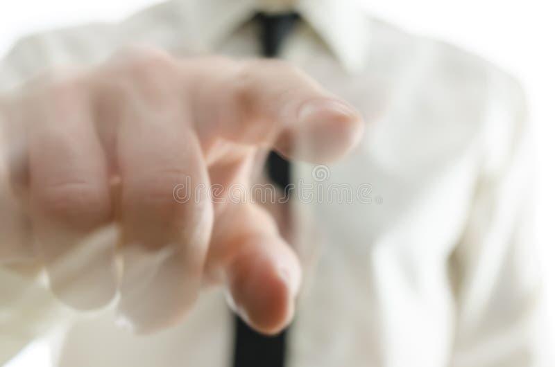 Mano borrosa que señala el finger hacia usted fotos de archivo libres de regalías