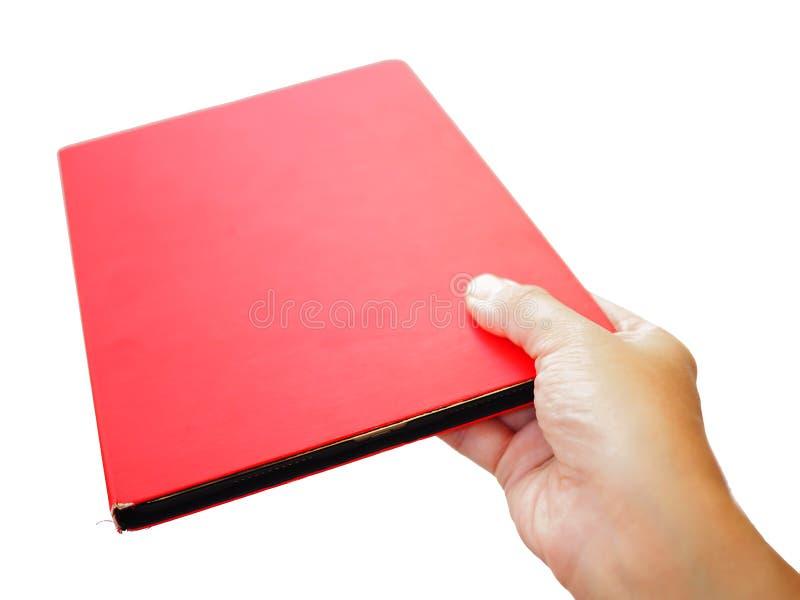 Mano che dà il libro rosso della copertura della compressa, fondo bianco immagine stock