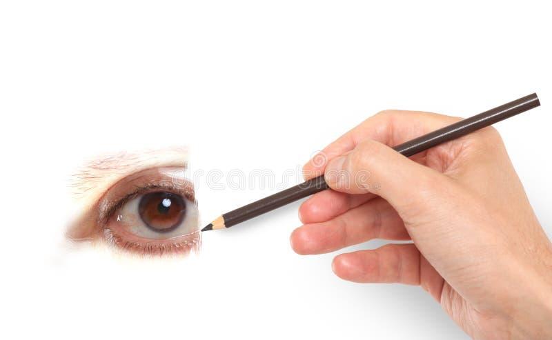 Mano che disegna un occhio umano fotografia stock libera da diritti