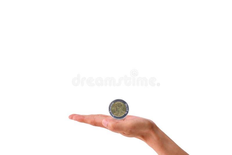 Mano che giudica baht della moneta d'argento isolata su fondo bianco illustrazione di stock