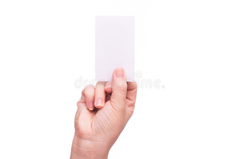 Mano che giudica biglietto da visita in bianco isolato fotografie stock