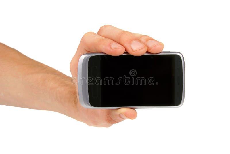 Mano che mostra telefono mobile fotografia stock libera da diritti