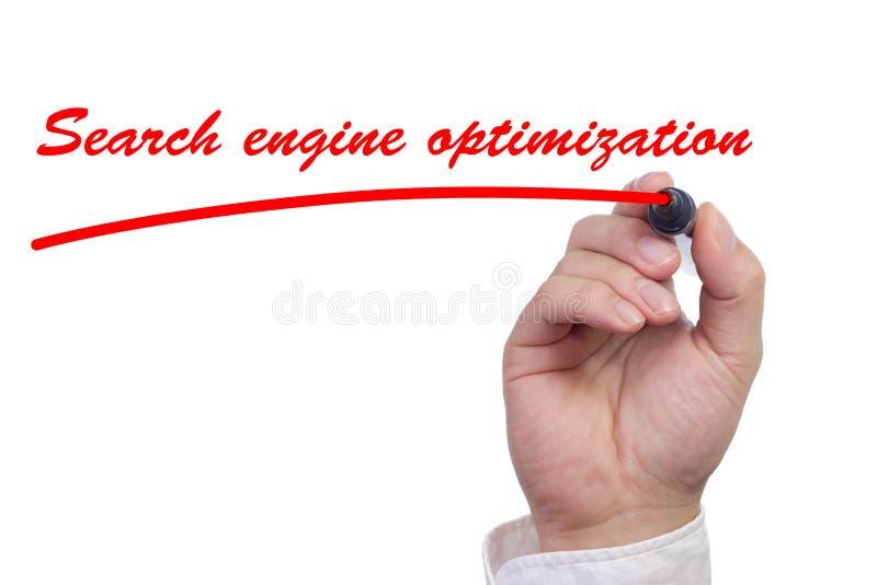 Mano che sottolinea l'ottimizzazione del motore di ricerca di parole fotografia stock libera da diritti