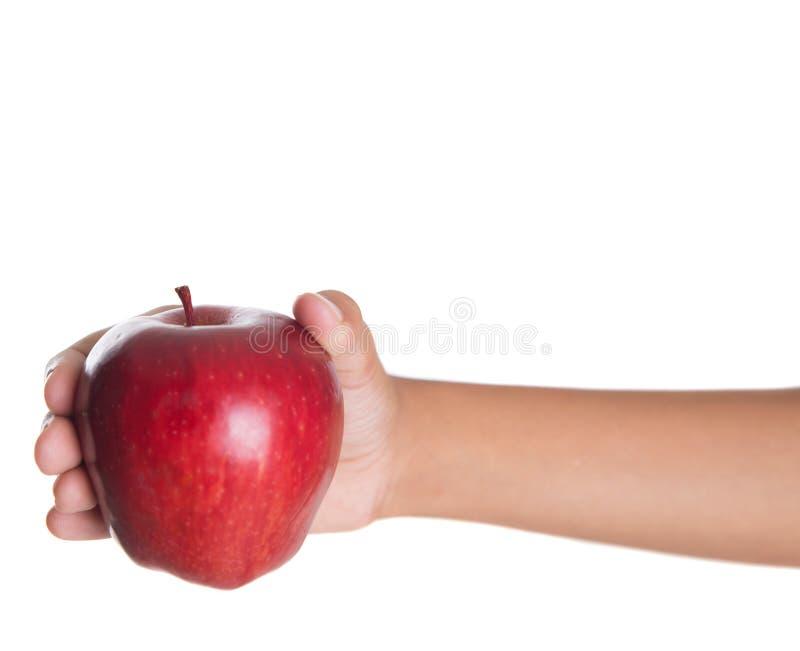 Mano che tiene Apple rosso II fotografia stock libera da diritti