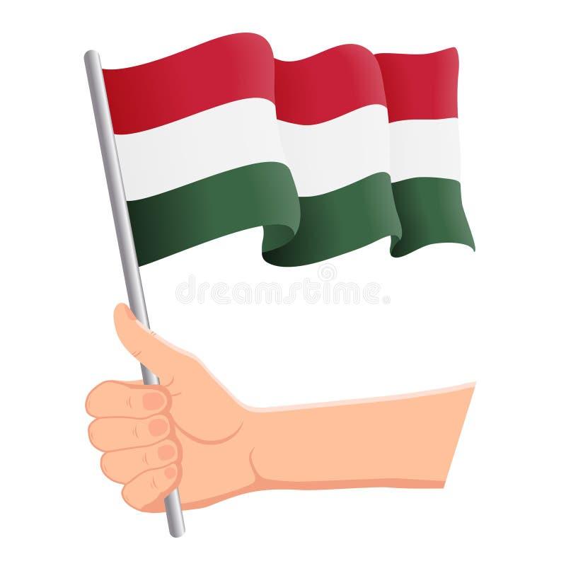 Mano che tiene e che ondeggia la bandiera nazionale dell'Ungheria r Illustrazione di vettore illustrazione di stock