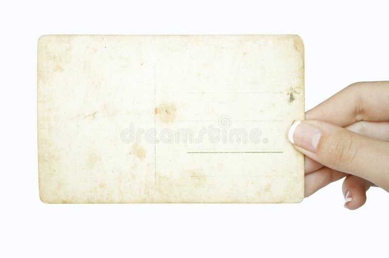 Mano che tiene la cartolina vuota del grunge fotografia stock libera da diritti
