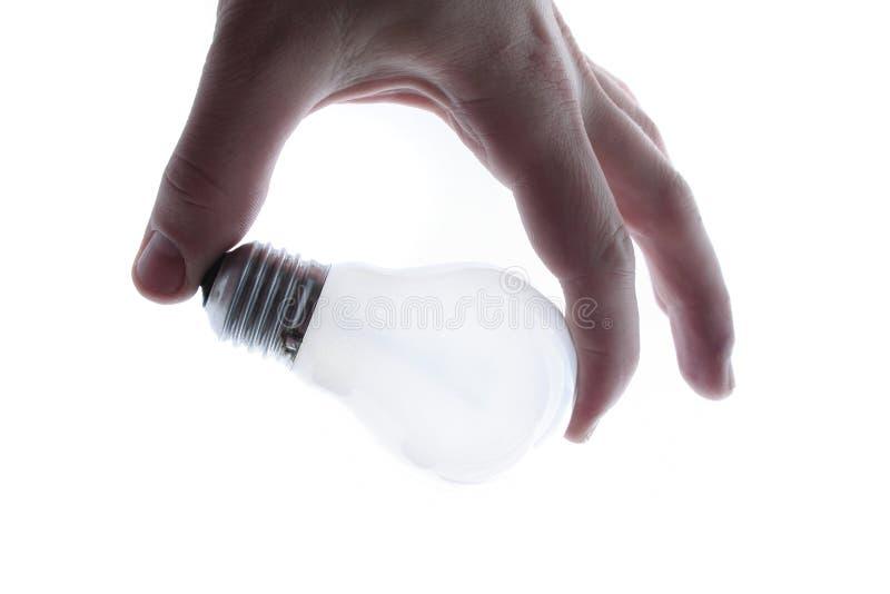 Mano che tiene lampadina immagini stock libere da diritti