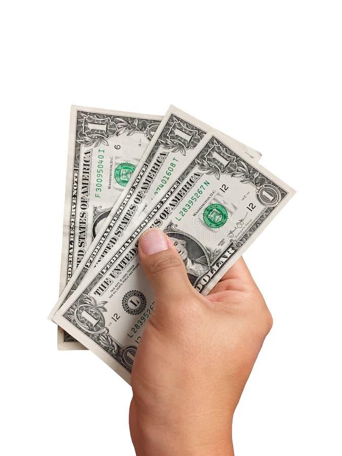 Mano che tiene le banconote in dollari su fondo bianco fotografia stock libera da diritti