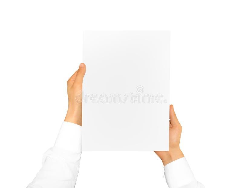 Mano che tiene lo strato della carta in bianco Carta intestata corporativa immagine stock