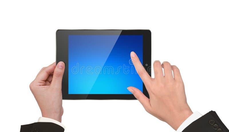 Mano che tiene un pc del touchpad. fotografia stock