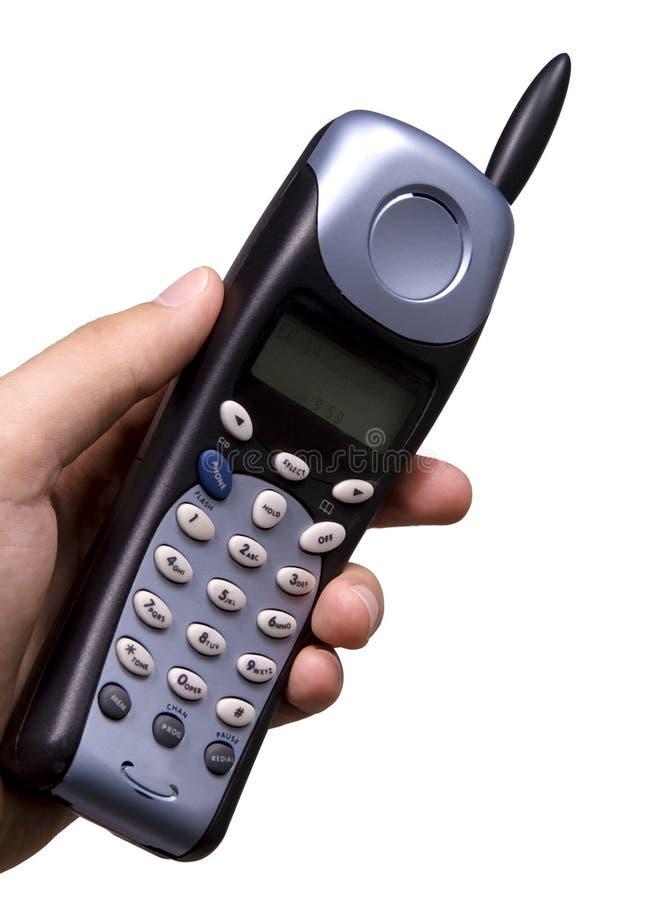 Mano che tiene un telefono fotografie stock