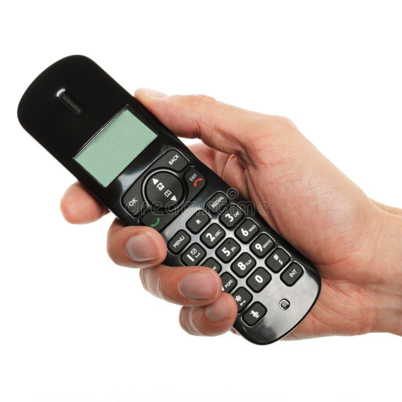 Mano che tiene un telefono immagini stock libere da diritti