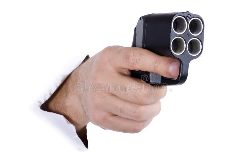 Mano con el arma traumático fotografía de archivo