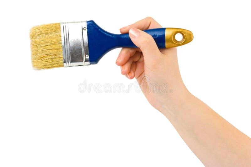 Mano con el cepillo fotos de archivo
