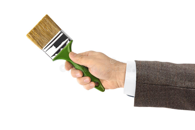 Mano con el cepillo foto de archivo libre de regalías
