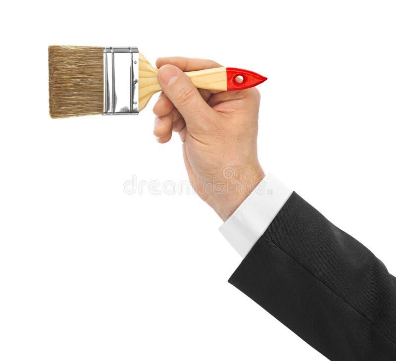 Mano con el cepillo imagen de archivo libre de regalías
