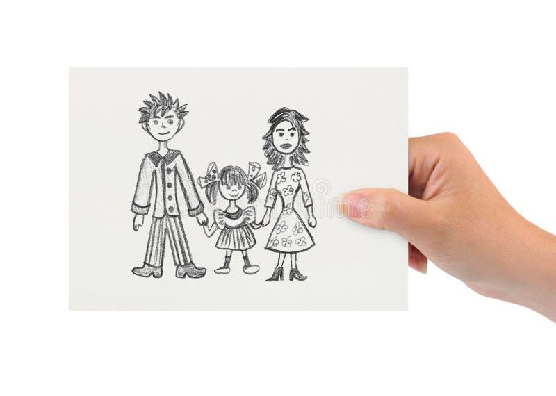 Mano con el dibujo de la familia feliz imagen de archivo