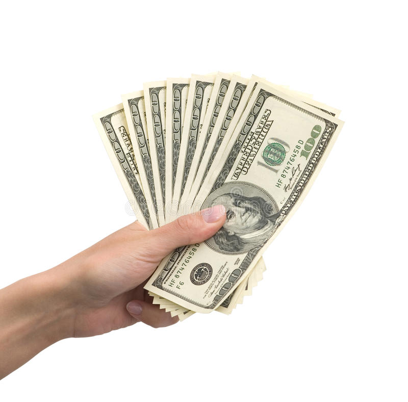 Mano con el dinero fotos de archivo