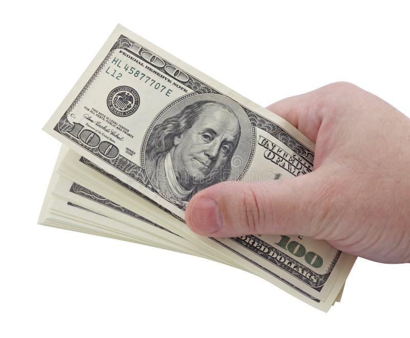 Mano con el dinero fotografía de archivo