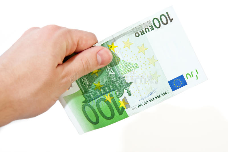 Mano con el euro 100 imagen de archivo