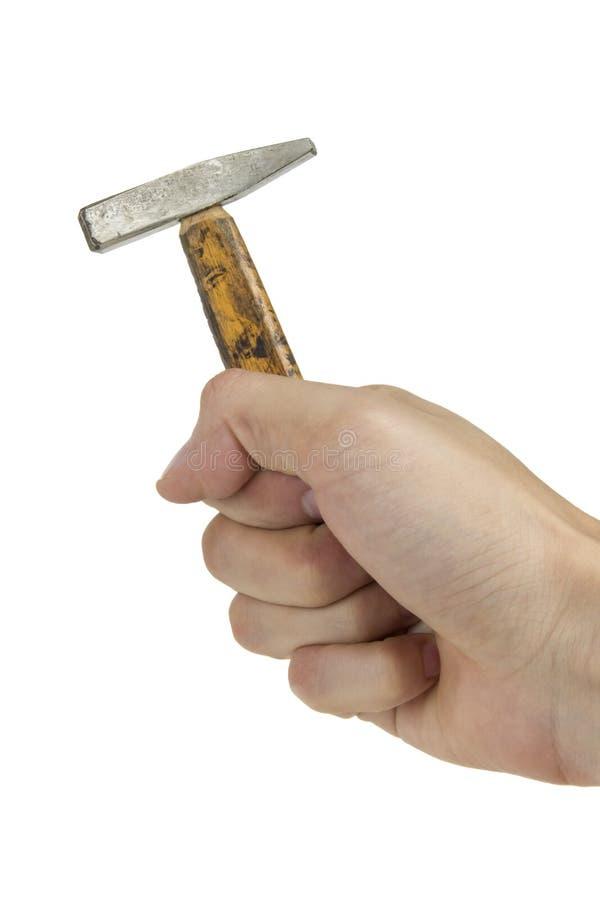 Mano con el martillo foto de archivo