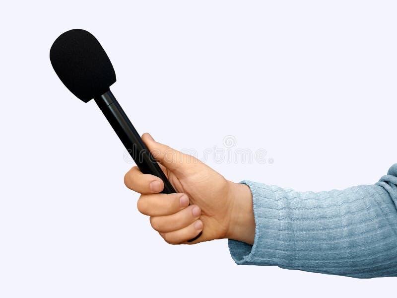 Mano con el micrófono fotografía de archivo