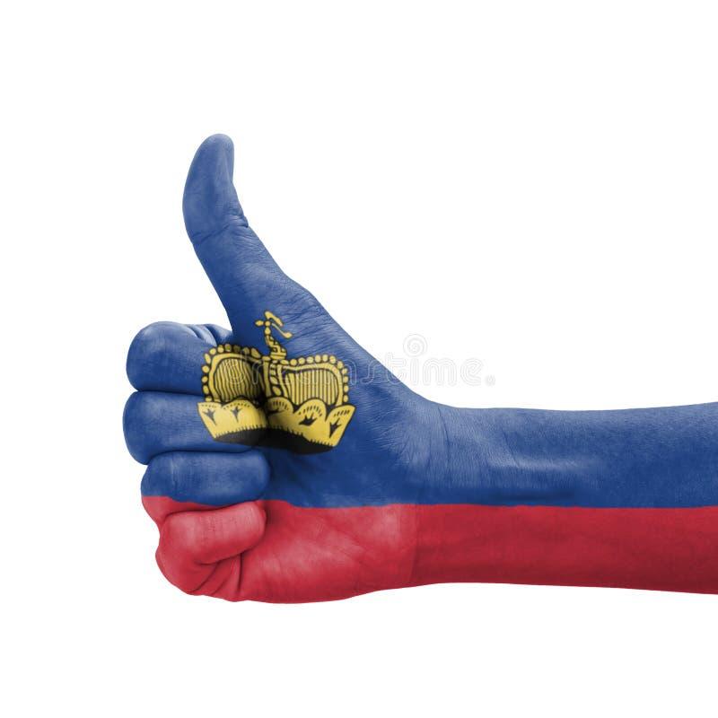 Mano con el pulgar para arriba, bandera de Liechtenstein pintada fotografía de archivo libre de regalías