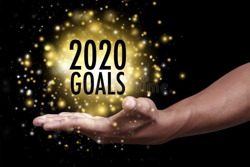 Mano con gli obiettivi 2020 fotografia stock libera da diritti