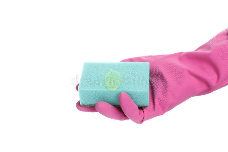 Mano con guantes que sostiene una esponja aislada en el fondo blanco fotos de archivo libres de regalías