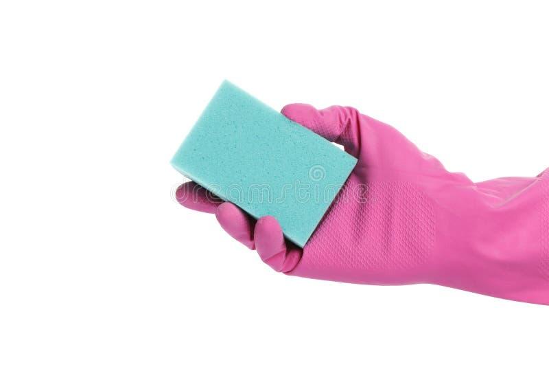 Mano con guantes que sostiene una esponja aislada en el fondo blanco imagenes de archivo