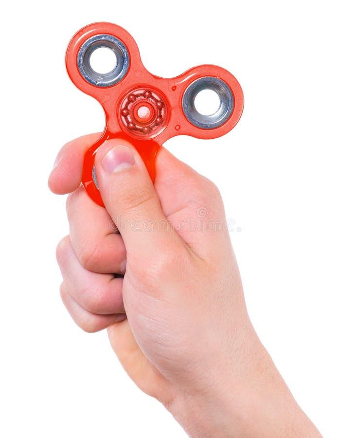 Mano con il giocattolo del filatore immagini stock libere da diritti