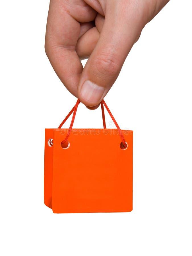 Mano con il mini sacchetto immagine stock