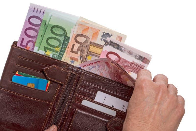 Mano con il portafoglio con le euro banconote immagine stock libera da diritti