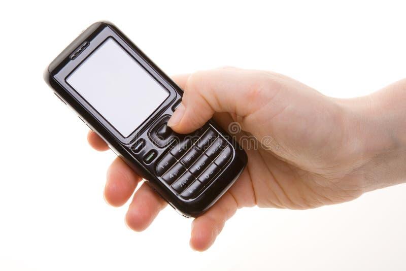 Mano con il telefono delle cellule fotografie stock