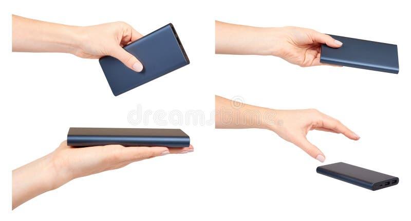 Mano con la banca, il dispositivo portatile, l'insieme e la raccolta scuri di potere immagine stock libera da diritti