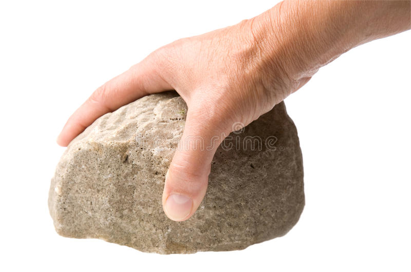 Mano con la roca fotos de archivo
