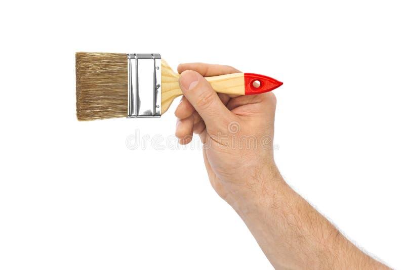 Mano con la spazzola fotografie stock libere da diritti