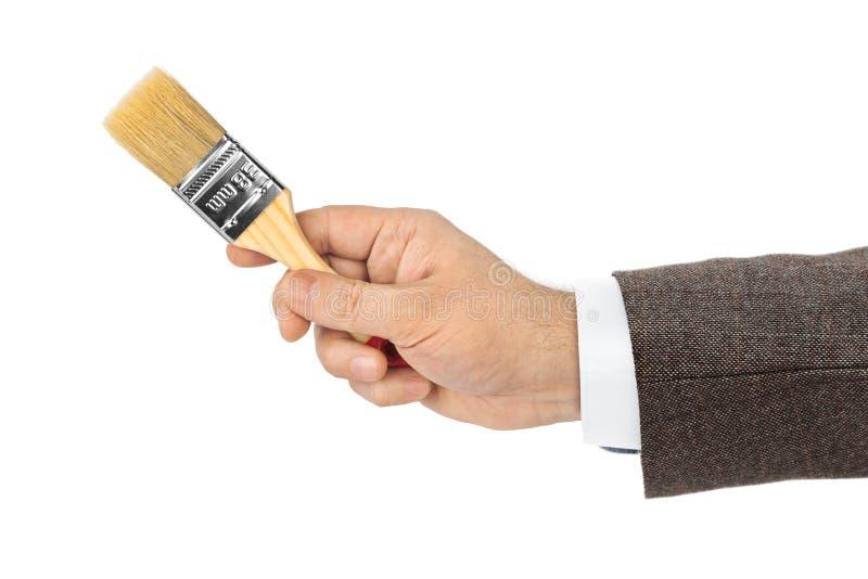 Mano con la spazzola immagine stock libera da diritti